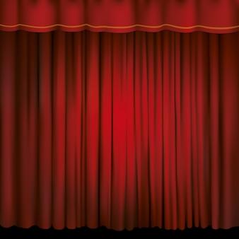 Reflektor na czerwonej kurtynie scenicznej.