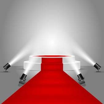 Reflektory i podium sceniczne z czerwonym dywanem