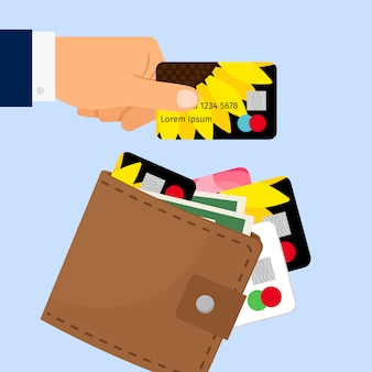 Ręka biorąc kartę kredytową z portfela