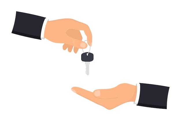 Ręka dająca klucze do domu klientowi. biznesmen w garniturze dając klucz do domu. koncepcja hipoteki, kredytu lub nieruchomości. sprzedaż i wynajem mieszkania. kupno domu. koncepcja sprzedaży i zakupu