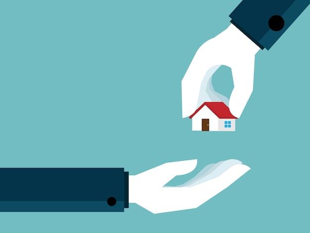 Ręka daje dom do ręki