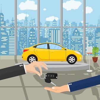 Ręka daje innej ręce kluczyki do samochodu
