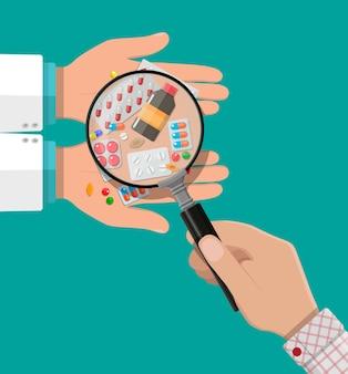 Ręka farmaceuty z pigułkami i lekami