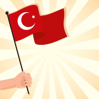 Ręka macha kraju flaga turcji na białym tle