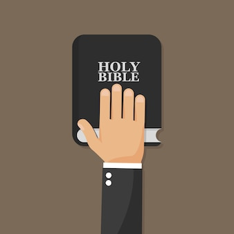 Ręka na biblii.