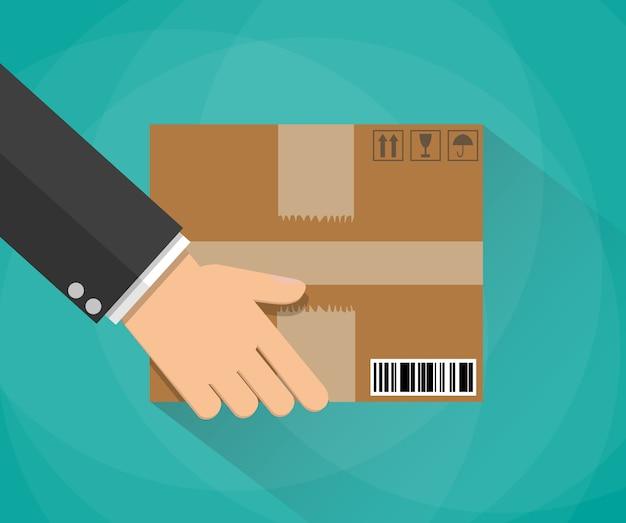 Ręka niosąca kartonowe pudełko