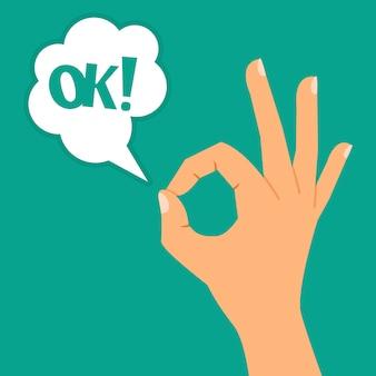 Ręka pokazuje ok szyldową ilustrację