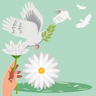 Ręka pokoju z kwiatem i gołębiem