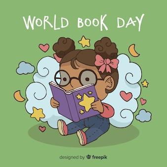 Ręka rysujący światowy książkowy dnia tło