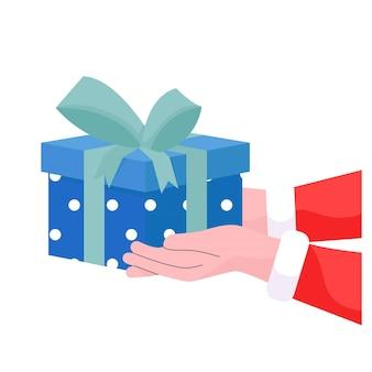 Ręka świętego mikołaja trzymająca pudełko na prezent świąteczny