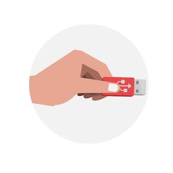 Ręka trzyma dysk flash usb