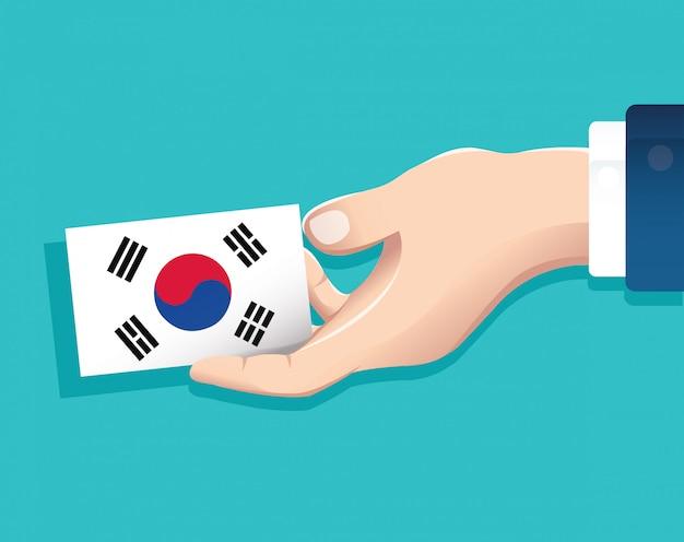 Ręka trzyma flagę flagi korei południowej