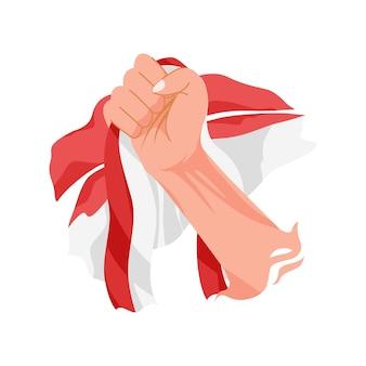 Ręka trzyma flagę indonezji. świętujemy dzień młodzieży