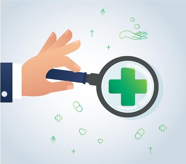 Ręka trzyma ikonę szkła powiększającego i medyczne