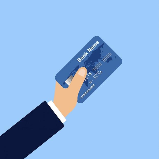Ręka trzyma kartę kredytową. płaska konstrukcja płatności online. wypłata gotówki. operacje finansowe.