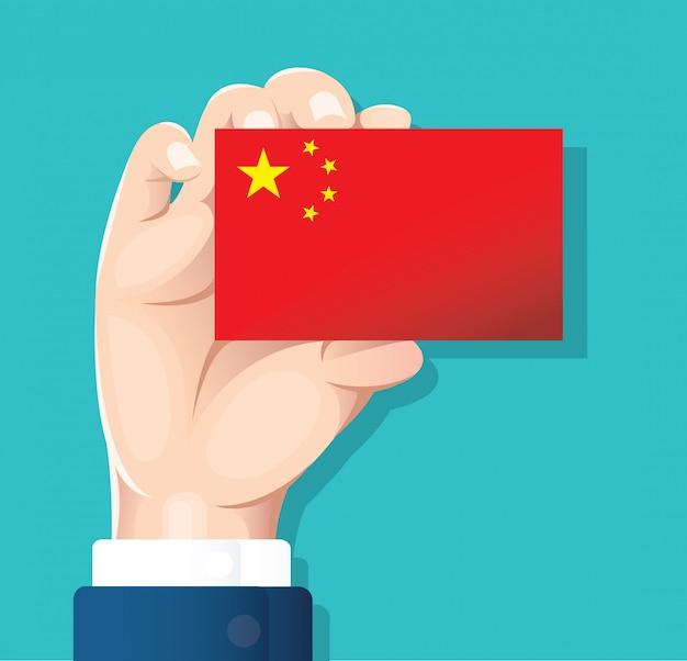 Ręka trzyma karty flaga chin
