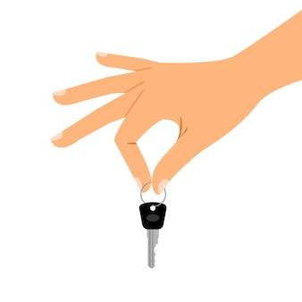 Ręka trzyma klucz na białym tle
