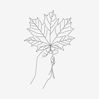 Ręka trzyma liść klonu w stylu sztuki linii
