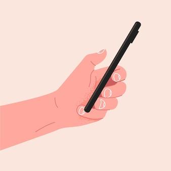 Ręka trzyma nowoczesną makieta inteligentnego telefonu komórkowego