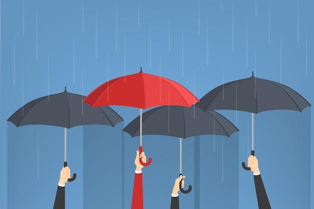 Ręka trzyma parasole. jeden mężczyzna z czerwonym parasolem wokół grupy szarych. idea indywidualności. na białym tle w stylu cartoon