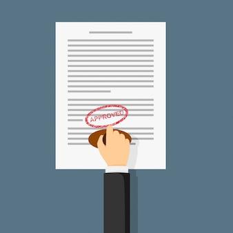 Ręka trzyma pieczątka. notariusz stempluje zatwierdzone słowo na papierze.