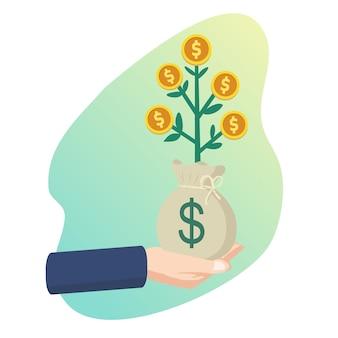 Ręka trzyma pieniądze drzewo