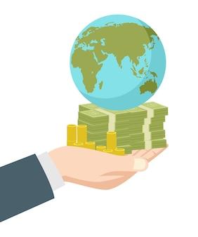 Ręka trzyma pieniądze i ziemskiej kuli ziemskiej