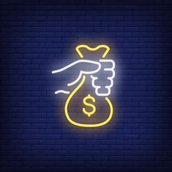 Ręka trzyma pieniądze torba neon znak