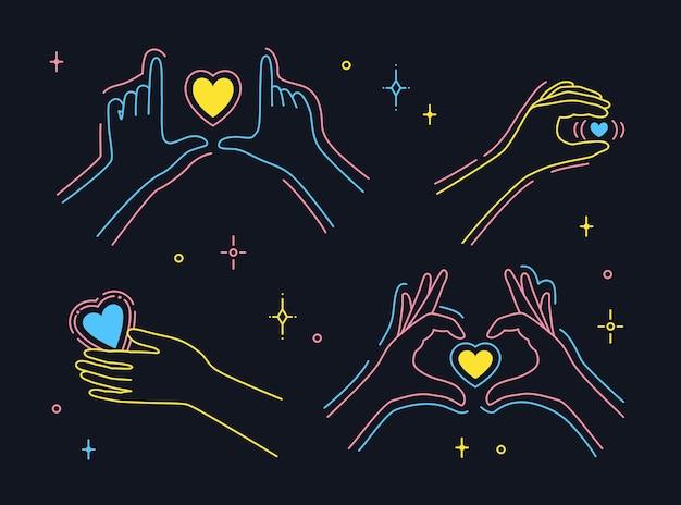 Ręka trzyma serce. symbol miłości palca, gesty rąk
