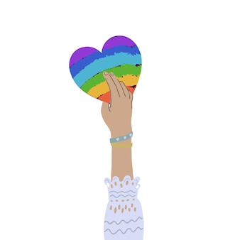 Ręka trzyma serce tęczy. równość, wspólnoty, koncepcja praw lgbtq. płaska ilustracja. ilustracja wektorowa