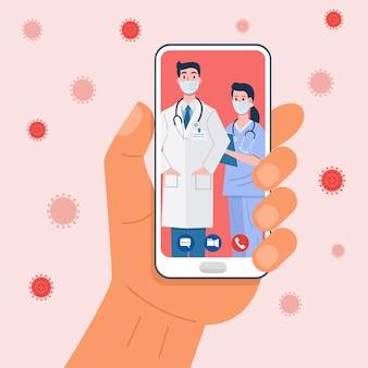 Ręka trzyma smartfon o wideokonferencji z lekarzem.
