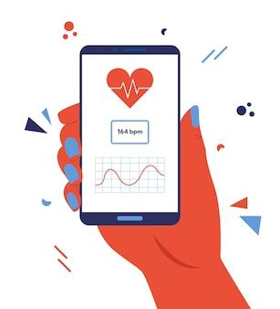 Ręka trzyma smartfon z aplikacją do monitorowania tętna.