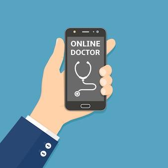 Ręka trzyma smartfon z aplikacją online lekarza na ekranie