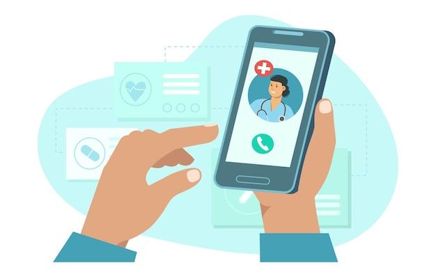 Ręka trzyma smartfon z lekarką na wezwanie i konsultację online usługa medyczna online