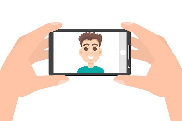 Ręka trzyma smartphone i robienie zdjęć, selfie.