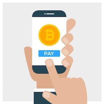Ręka trzyma smartphone i zapłacić bitcoin