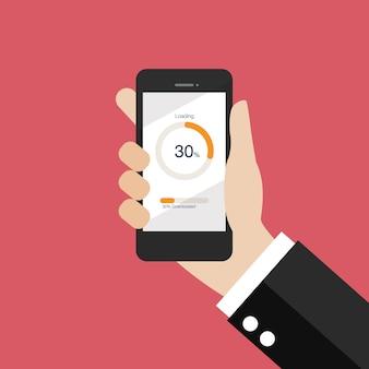 Ręka trzyma smartphone z kręgu ładowania i paski postępu