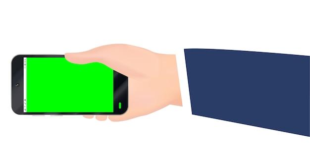 Ręka trzyma smartphone z zielonym ekranem wektor