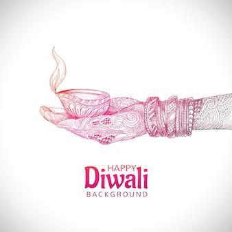 Ręka trzyma szkic indyjskiej lampy naftowej festiwalu diwali