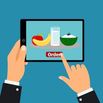 Ręka trzyma tabletkę, zamówić jedzenie
