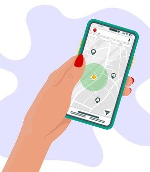 Ręka trzyma telefon z mapą i markerem