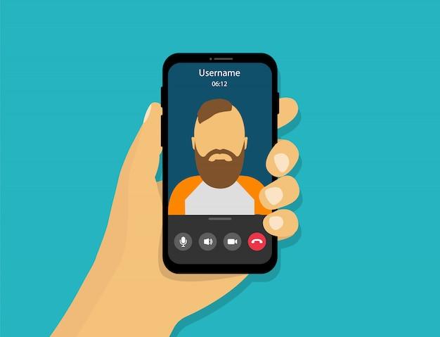Ręka trzyma telefon z rozmową wideo. rozmowa wideo na smartfonie w stylu kreskówkowym.