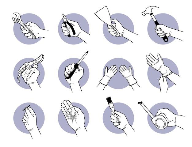 Ręka trzyma wyposażenie narzędzi pracy.