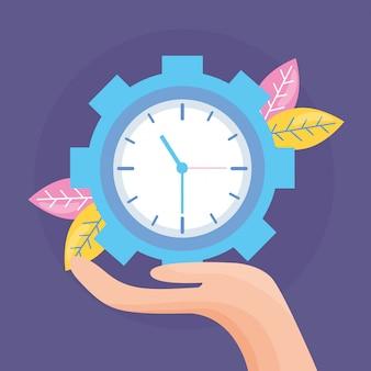 Ręka trzyma zegar