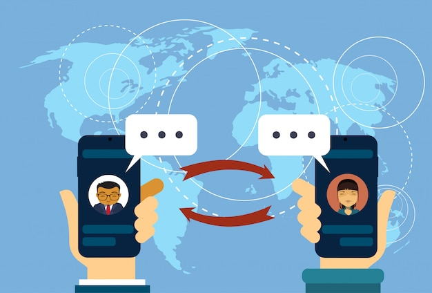 Ręka trzymaj smart phonesover world map