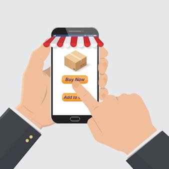 Ręka trzymaj smartfon w ręku, aby zamówić online.