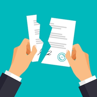 Ręka trzymająca złamaną lub podartą umowę zmięte arkusze papieru koncepcja rozwiązania umowy
