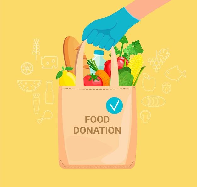Ręka w rękawiczki z torbą pełną darów żywnościowych, dobroczynności i solidarności podczas pandemii covid-19. wolontariusze pomagają potrzebującym, biednym, starym, bezdomnym i chorym. koncepcja darowizny spożywczej. ilustracja wektorowa.