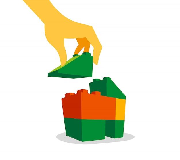 Ręka wkładająca ostatni element do ukończenia domu