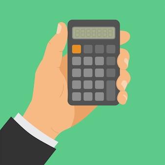 Ręka z kalkulatorem, mężczyzna trzyma kalkulator w ręku.